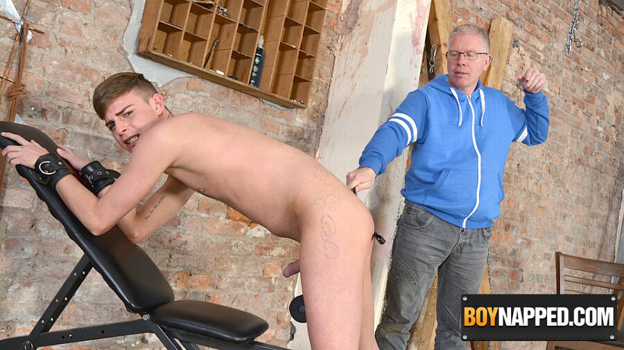 The naked boy is cuffed and restrained in a standing position to start, his  plump arse spanked and beaten ...